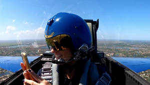 Marjory Stoneman Douglas High School Principal Michelle Kefford taking photos of her school aboard U.S. Navy Blue Angels jet.
