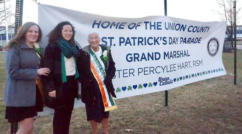 Sister Percylee with UC sign.png