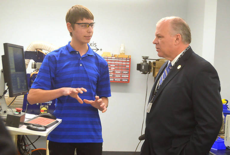 Stephen Mazza, AIT student, demonstrates Tormac machine to Sen. Sweeney.png