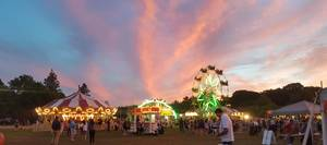 Carousel image ca4ea9a7ed64957464d5 74bffd930ecaed36cdd6 st. therese carnival 2019 sunset in roxbury