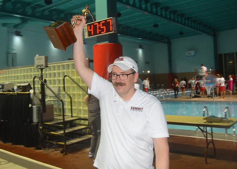 Summit Coach hoists trophy.png