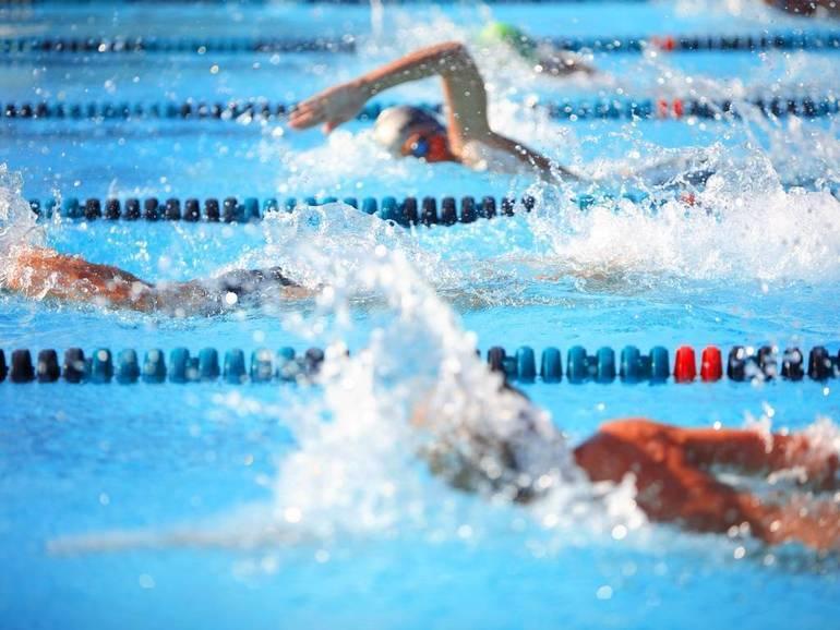 Swimming: Morristown Boys and Girls Swimming Over Morristown Beard
