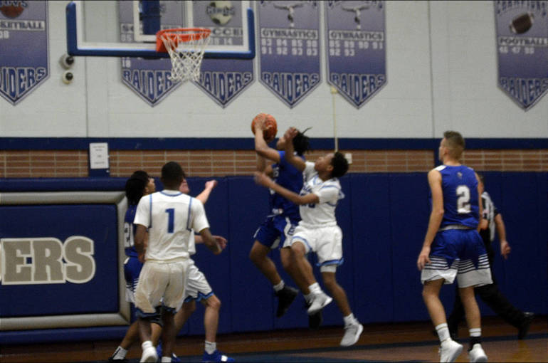 UC player goes for a layup vs. Scotch Plains-Fanwood.png
