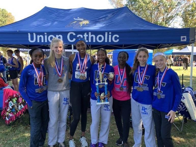 UC girls 2019 Shore Coaches.JPG