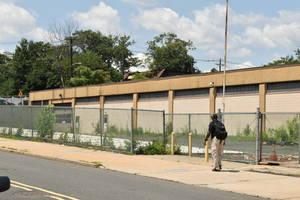 Person walks past a lot in Elizabeth NJ