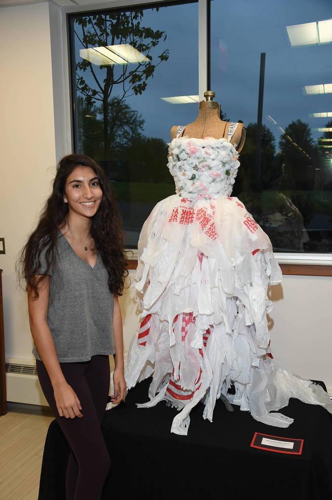 Camila Martinez of Scotch Plains proudly displays her creative art work.