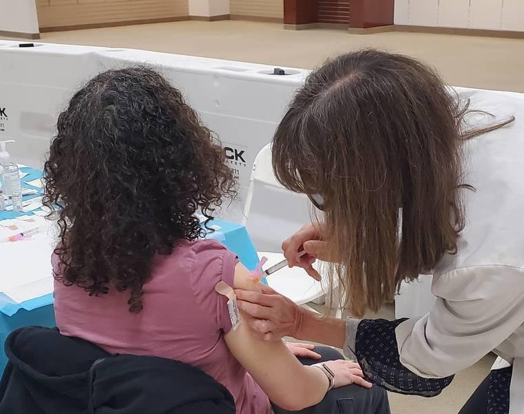 Child receiving a vaccine