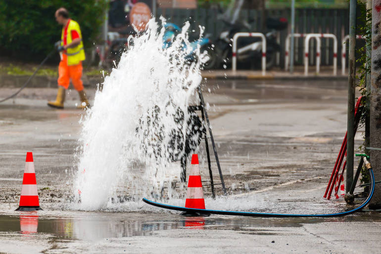 Road Work Continues Tuesday Evening at Site of Water Main Break in Clark