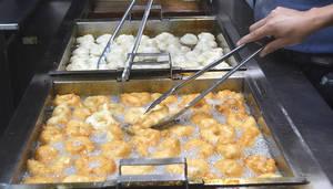 zeppoles frying in deep fryer